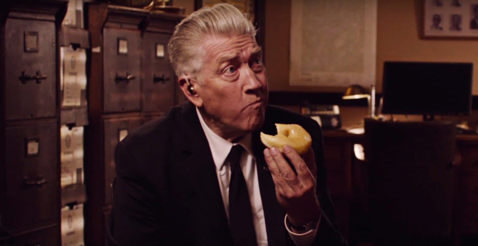 David Lynch as Gordon Cole eats a donut