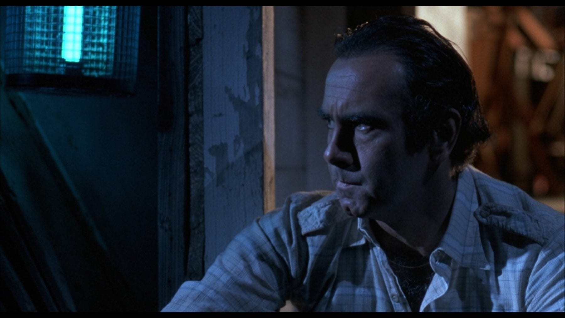 Marty (Dan Hedaya) intensifty grows as he ponders having his wife and her lover murdered.