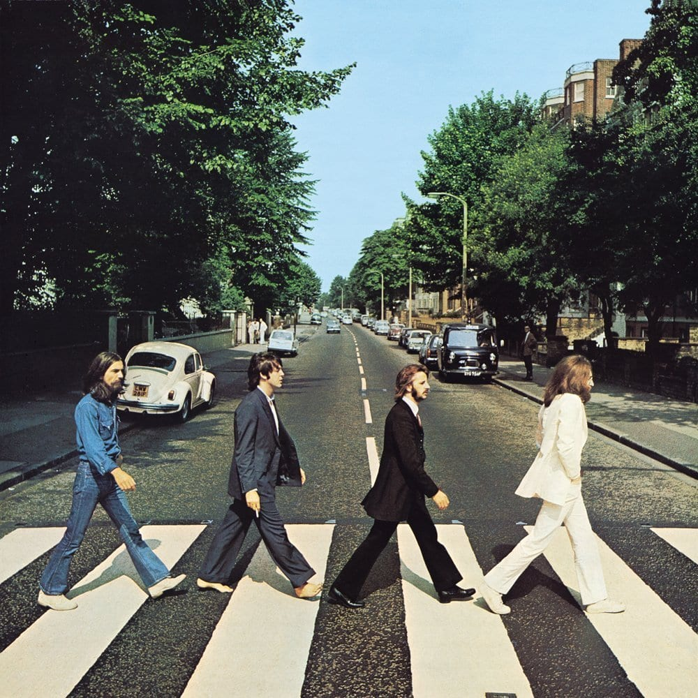 The Beatles Abbey Road album cover showing John Lennon Ringo Starr Paul McCartney and George Harrison crossing a London crosswalk