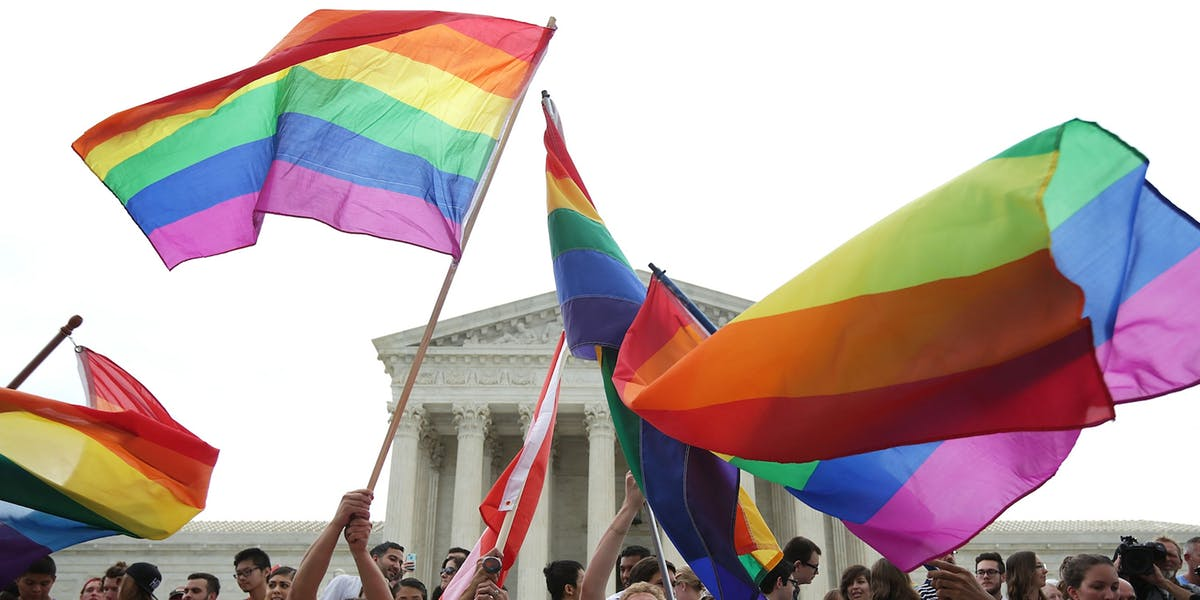 People with Pride flags