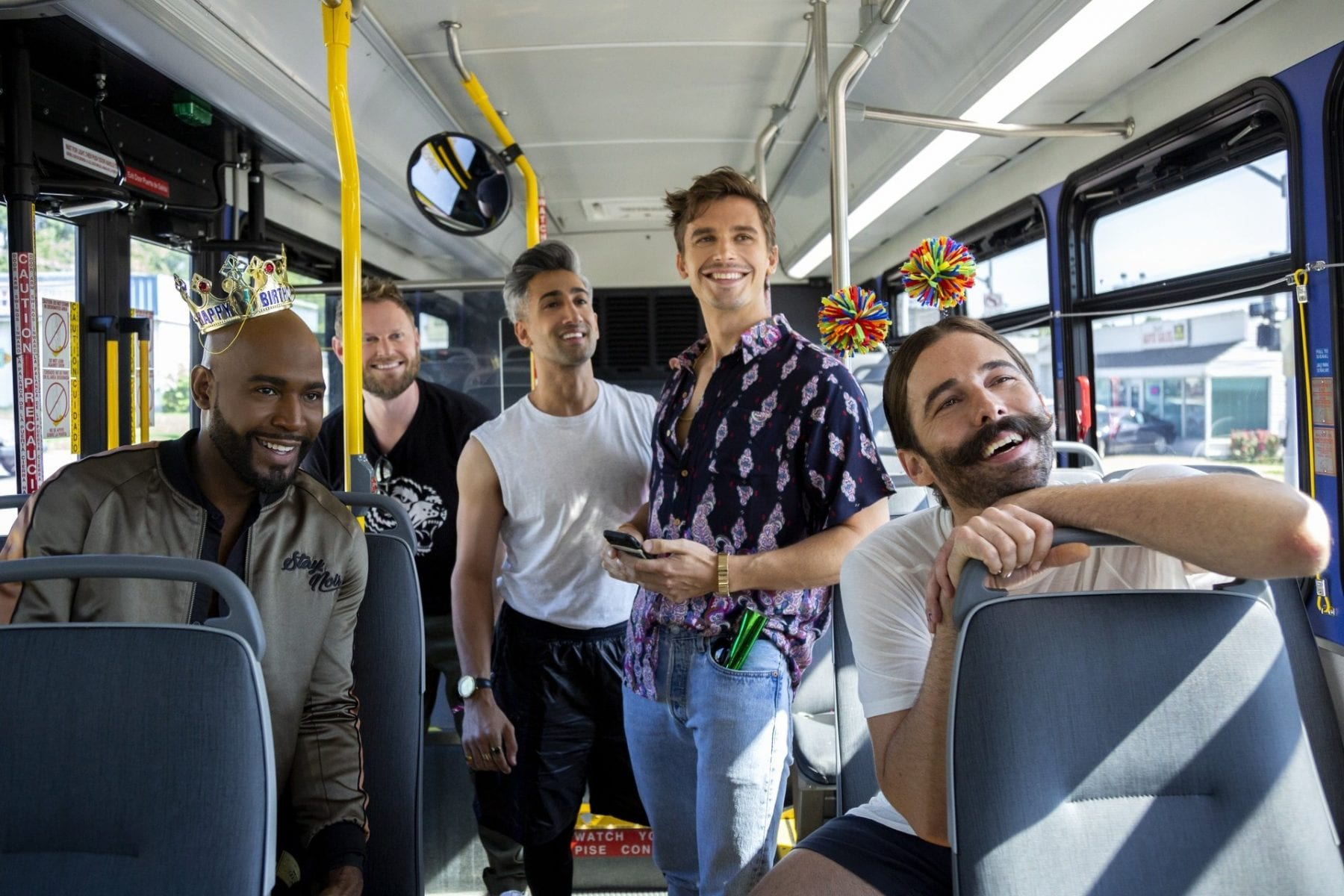Karamo, Bobby, Tan, Antoni, and JVN on a bus in an episode of Queer Eye