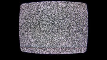 Snow appears on a TV screen because of gravity