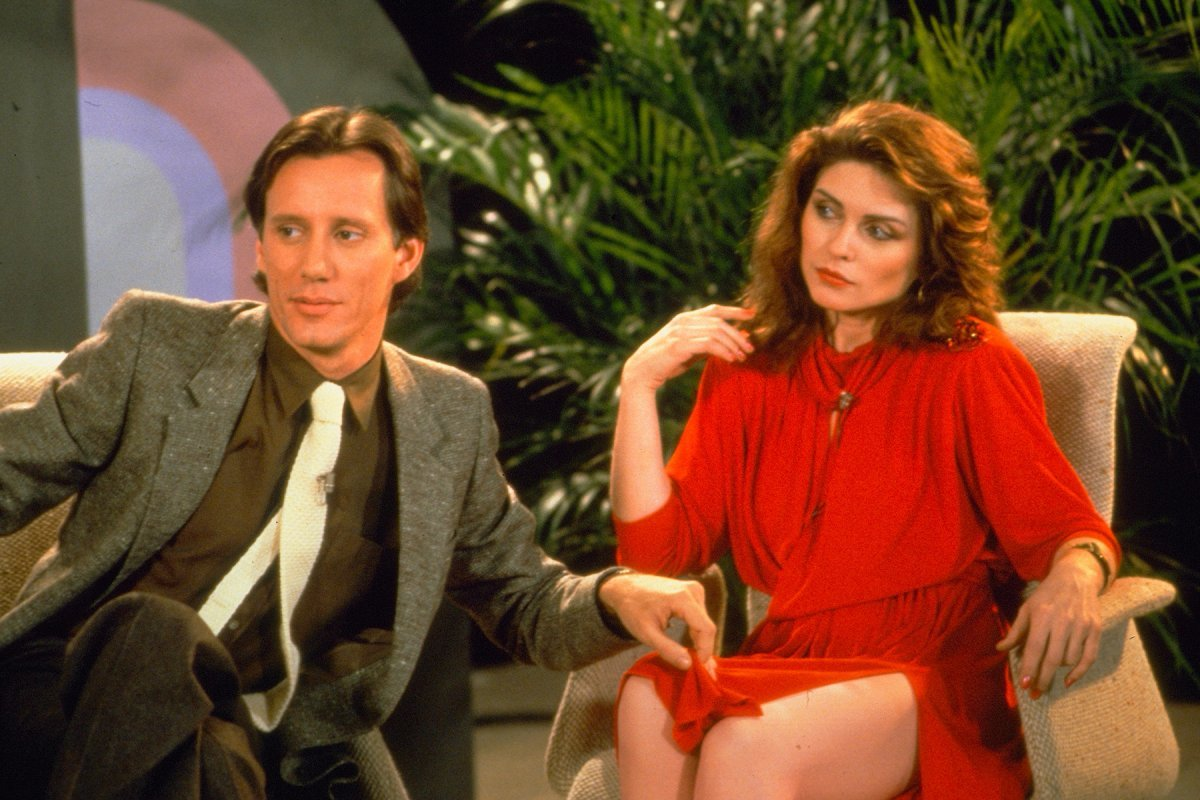Max Renn (James Woods) and Nicki Brand (Deborah Harry) on a talk show discussing the effects of sex and violence on modern culture in Videodrome (1983).