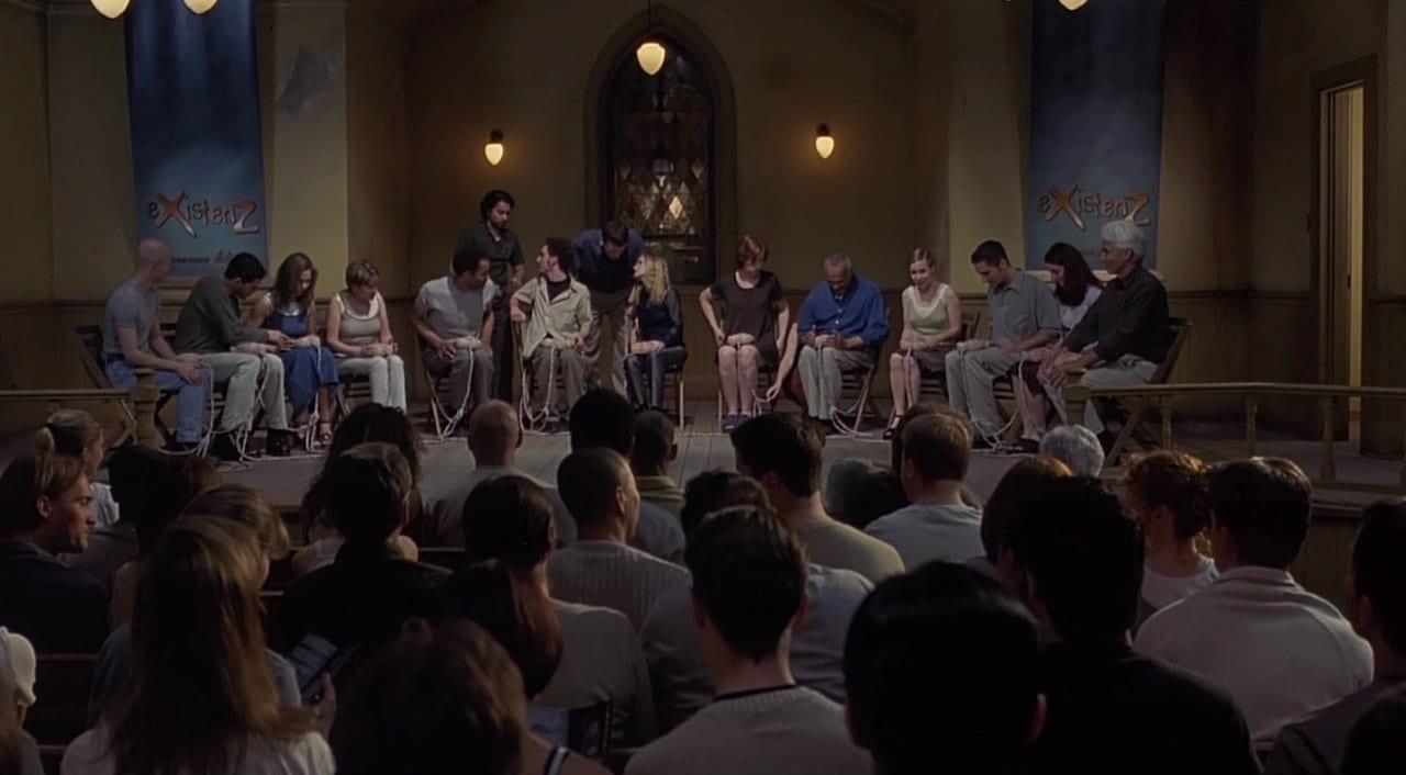Jennifer Jason Leigh as Allegra Geller in the opening scene of eXistenZ (1999).