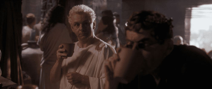 Aziraphale and Crowley hold cups in Good Omens