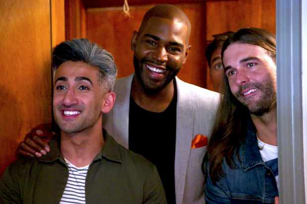 Tan, Karamo, and Anthony stand in a doorway, Anthony cries