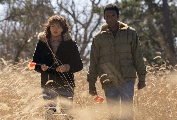 Amelia (Carmen Ejogo) and Wayne (Mahershala Ali) walk through a field in HBO's True Detective