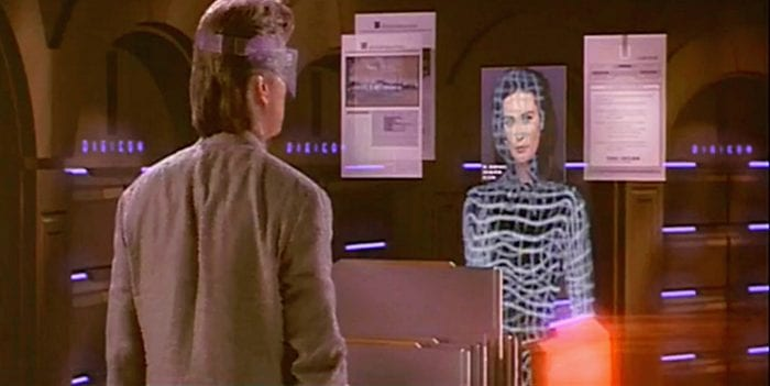 Michael Douglas faces a virtual representation of Demi Moore in a virtual world.