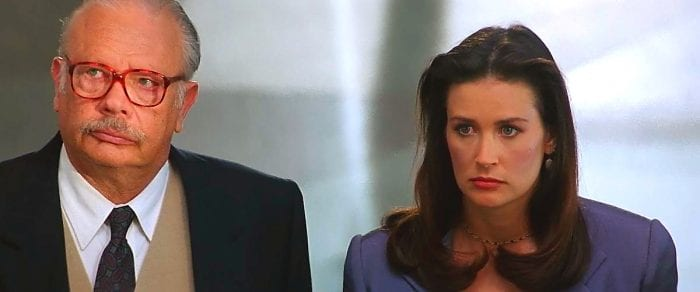 Demi Moore and her lawyer looking pensive