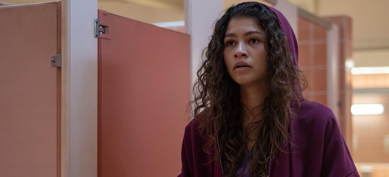 Rue (Zendaya) wearing a red hooded sweatshirt in the bathroom in HBO's Euphoria