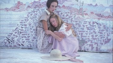Millie (Shelley Duvall) holds PInky (SIssy SPacek) in Robet Altman's avant garde identity film 3 Women (1977).