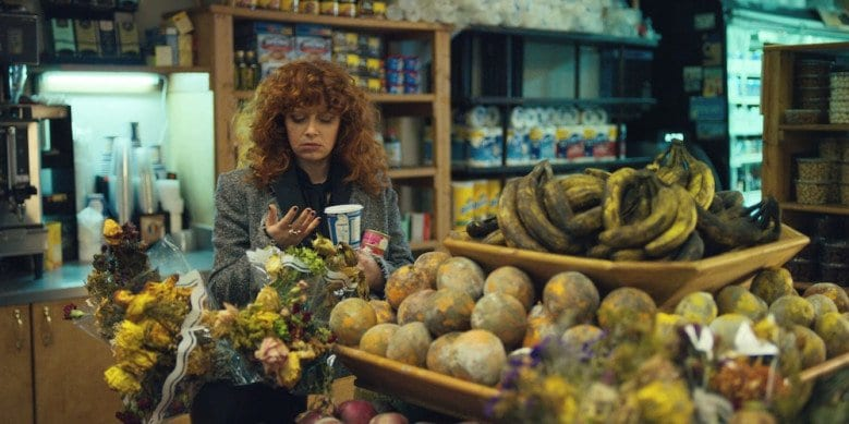 Nadia notices all the rotten fruit in a store in Russian Doll.