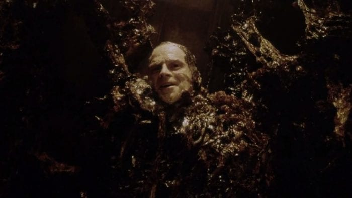 Brad Dourif is being Brad Dourif while slimed in Alien goo in Alien: Resurrection