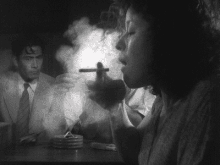 Murakami (Toshiro Mifune) looks on as leads to his stolen Colt go up in smoke in Akira Kurosawa's Stray Dog