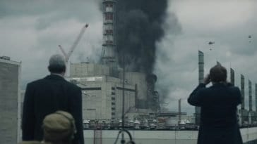 Legasov and Shcherbina watch helicopters attempt to put out the fire at the Chernobyl power plant