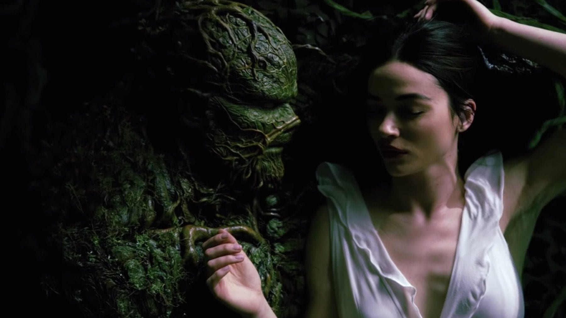 Dr. Abby Arcane (Crystal Reed) and what was once Alec Hollan (Derek Mears) embrace in a promo for DCUniverse's Swamp Thing.