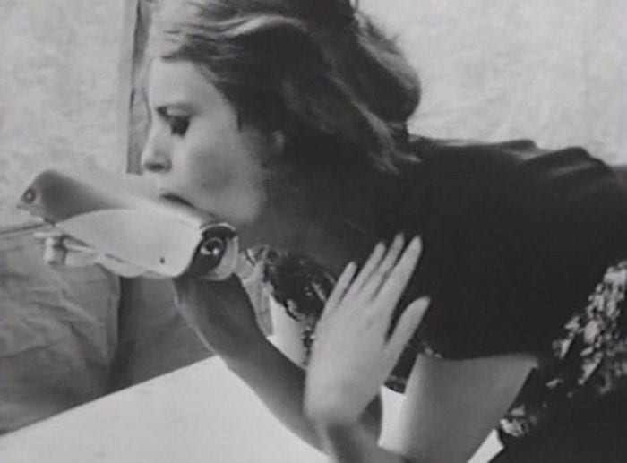 Woman licking a shoe in Multiple Maniacs