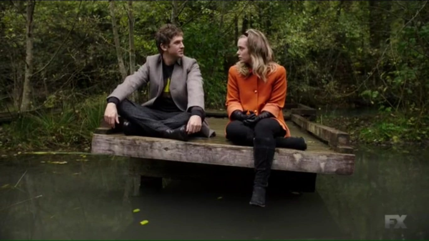 Syd and David sit by the water in Legion