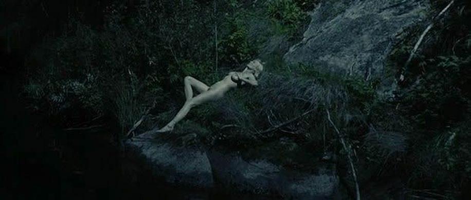 Justine from Lars von Trier's Melancholia moonbathing in light of Melancholia planet