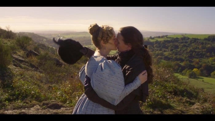 Ann Walker (Sophie Rundle) and Anne Lister (Suranne Jones) share a passionate kiss on the hillside in Gentleman Jack.