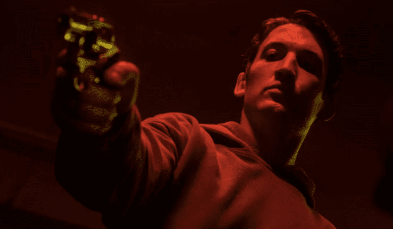 Martin Jones (Miles Teller) carries out one of his killings for ganglord Damian.