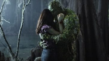 Swamp Thing (Derek Mears) and Dr. Abby Arcane in a tender embracde.