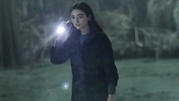 Dr Abby Arcane (Crystal Reed) searches the swamps for Alec Holland (Andy Bean).