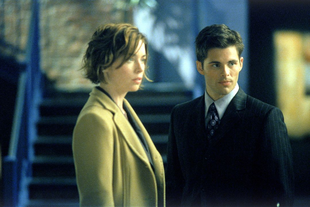Jenny Shaw and Glenn Foy stand in the law office of Ally McBeal even though it appears they are the main characters of the show now.