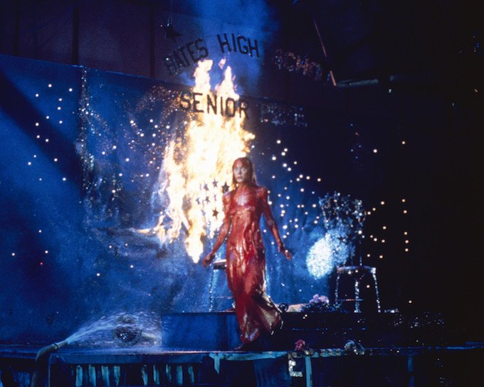 Carrie White (Sissy Spacek) uses her telekinetic powers to take revenge against her cruel classmates on prom night in Brian DePalma's Carrie (1976).