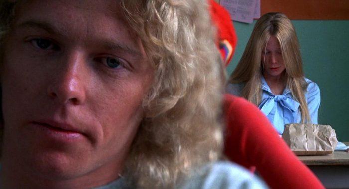 Carrie White (Sissy Spacek) admires Tommy Ross' (William Katt) poem in Brian DePalma's Carrie (1976).