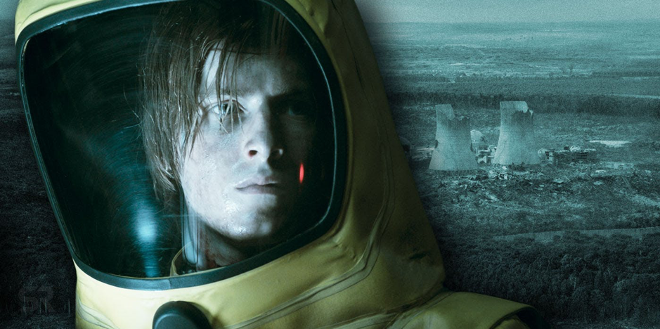 Jonas in a hazmat suit next to a nuclear power plant in Dark on Netflix