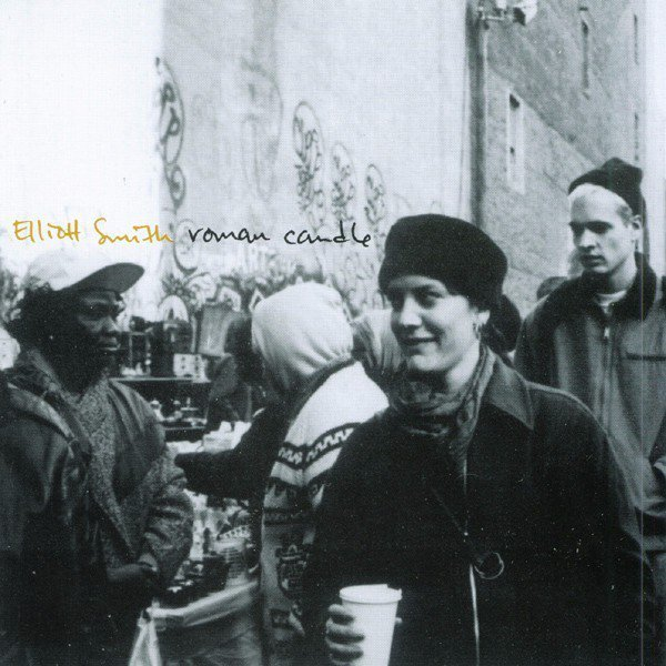 The cover for Elliot Smith Roman Candle is a candid shot of the singer holding a coffee cup, a picture he chose for its authenticity.