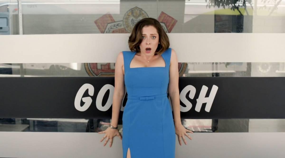 Rachel gasps in front of the word 'Gosh'