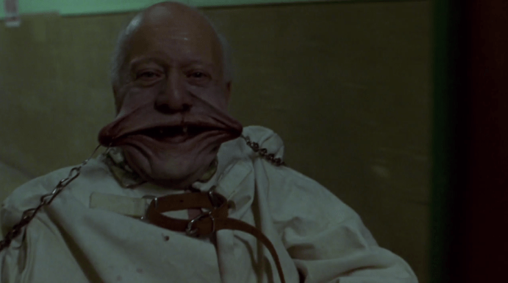 An old man is forced into a smile and laughs like a child in a memorable scene in Hellraiser: Inferno.