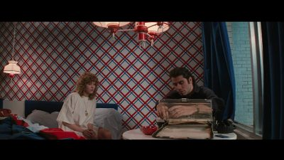 Sally (Nancy Allen) and Jack (John Travolta) sit in a bedroom.
