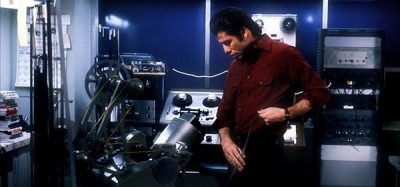Jack (John Travolta) looking at equipment in a studio.