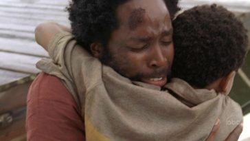 Michael and Walt hug as they are reunited at the dock