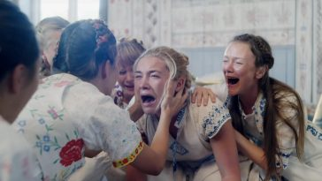 Dani screams while surrounded by the females of the cult in Midsommar