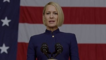 Clare Underwood stands in front of the American Flag in House of Cards S6
