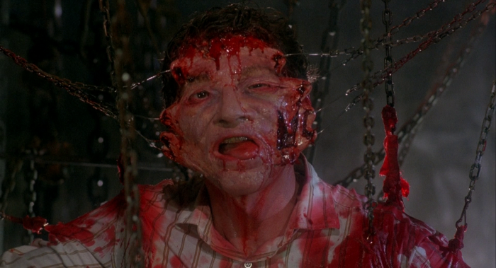 Frank-as-Larry with hooks in his face in Hellraiser