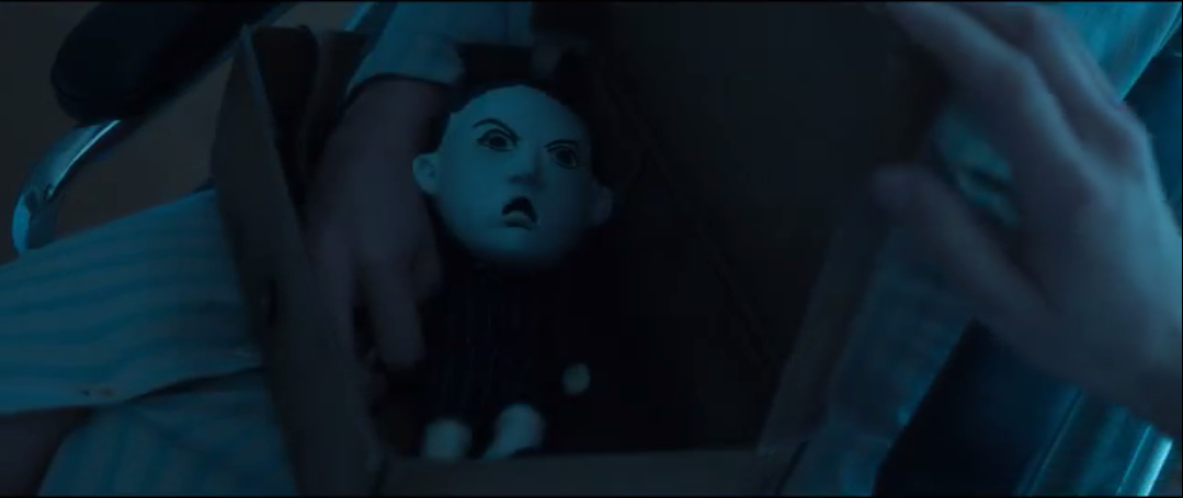 Gabrielle has a box with an Angriest Boy in the World doll in Legion