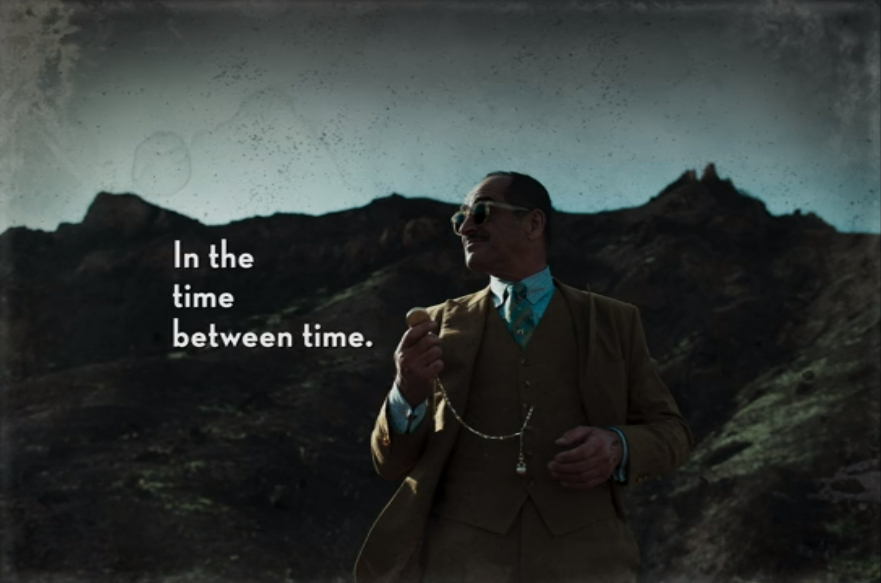 Farouk says they are in between time while he holds his pocketwatch and looks off into the distance while standing in front of a mountain
