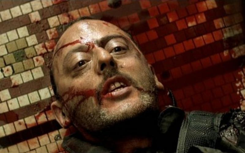 Leon uttering his last words laying on a floor in a pool of his own blood