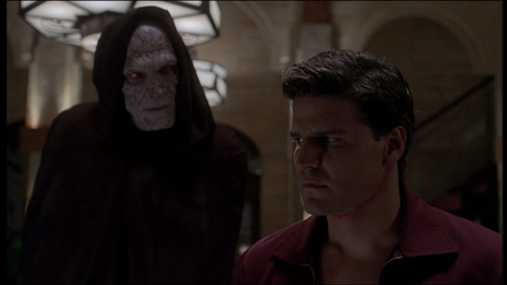 The Thesulac demon hovers over Angel's shoulder