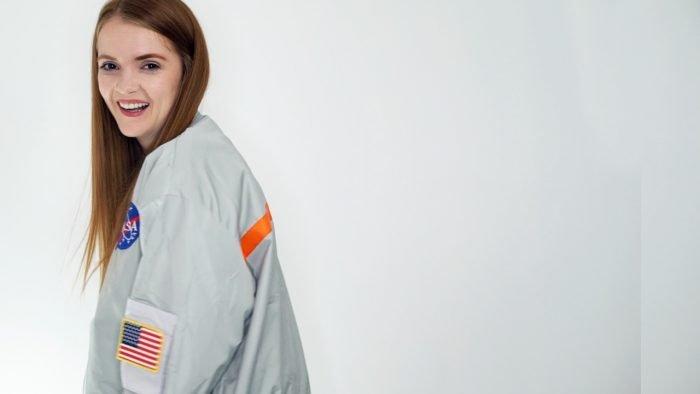 Horror YouTuber Spookyastronauts poses in here NASA jacket