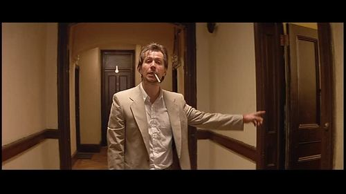 Stansfield directing his men into Mathilda's flat