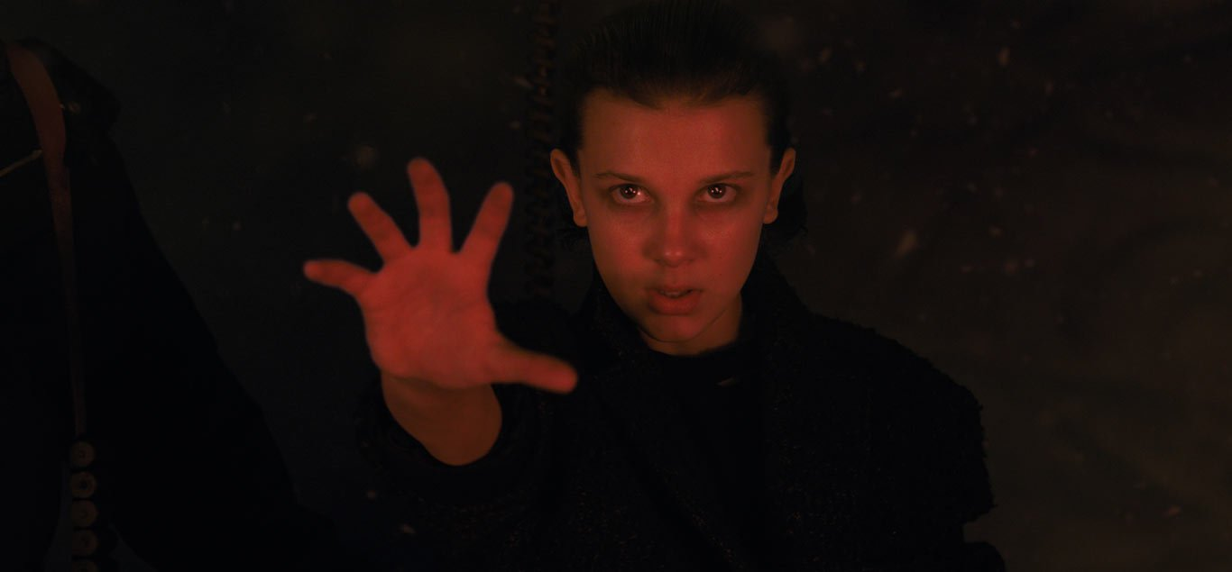 Hand outstretched, Eleven uses her powers to close the gate to the Upside Down
