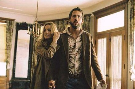 Married couple George and Kathy Lutz look around their new house in The Amityville Horror (2005).