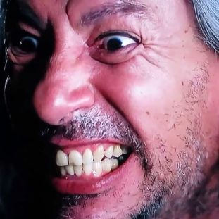 close up of BOB from Twin Peaks snarling with gritted teeth and intense eyes.