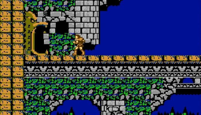 Simon crosses the bat infested bridge and approaches a doorway shaped like a golden bird with it's mouth open.
